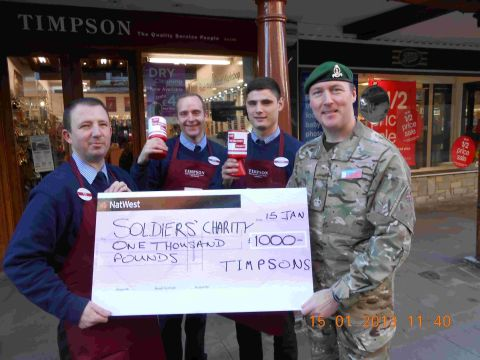 Winchester cobblers raises £1,000 for army charity