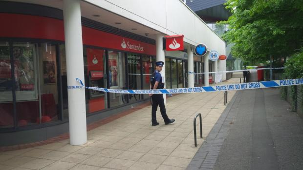 UPDATE: Police hunt van after masked hammer raid at city bank