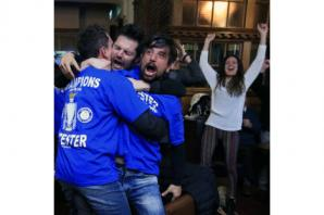 Leicester City fans mob restaurant to catch glimpse of heroes